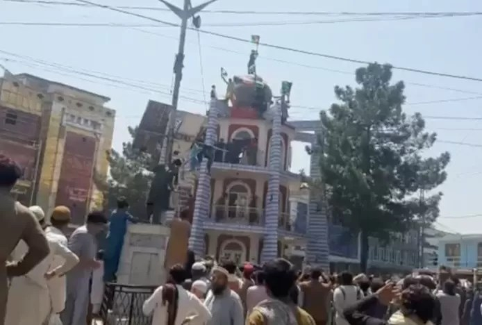 At least two killed in protests against Taliban flag