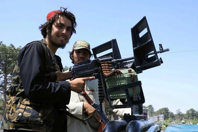 Taliban fighters patrol a street in the city of Herat.