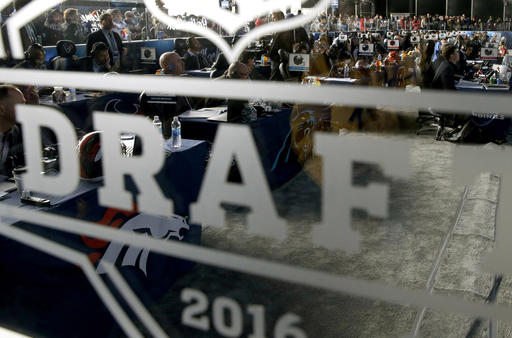 Representatives from NFL football teams work during the last day of the 2016 NFL Draft on Saturday, April 30, 2016, in Chicago. (AP Photo/Nam Y. Huh)