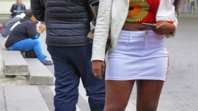 Photo of Nigerian lady harassed by a Nigerian man for wearing a short dress in a foreign country (video)