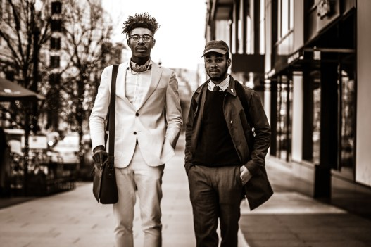 Two young black, dapper men walk the streets of North West, Washington D.C.