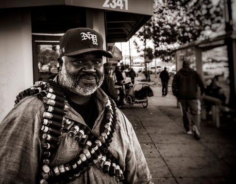 The Cologne Bandolier. Middle-aged black man, selling cologne on the streets of D.C. 2015.