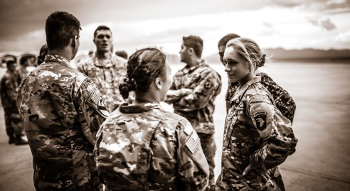 Two female Army Officers, speaking to each other.