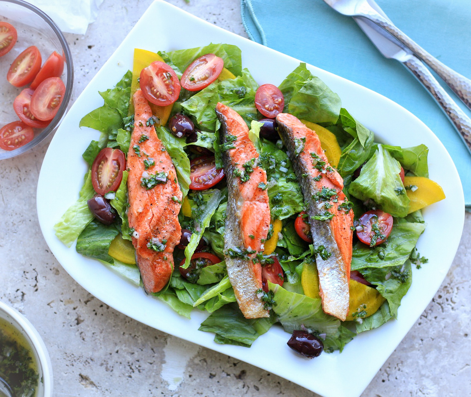 Simple grilled salmon salad with romaine and yellow beets