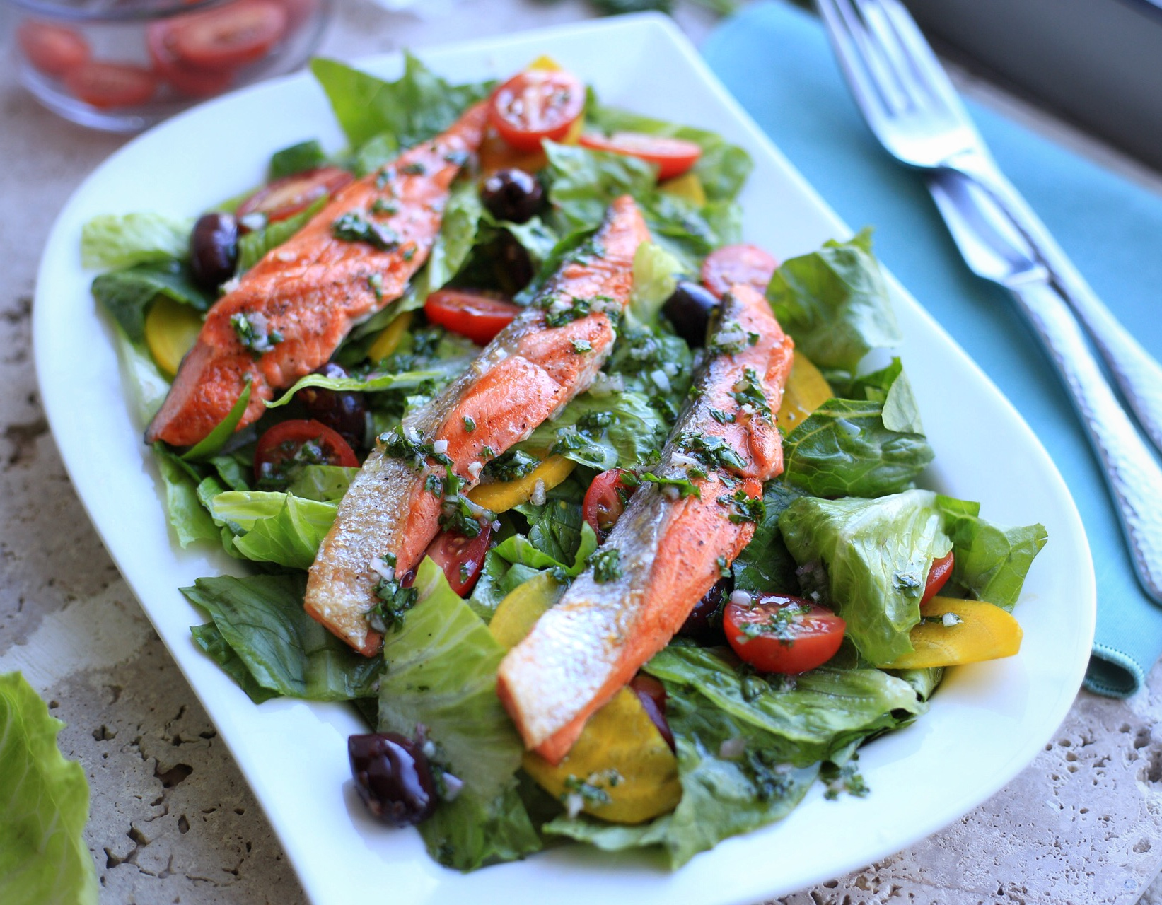 Grilled salmon salad with romaine and yellow beets