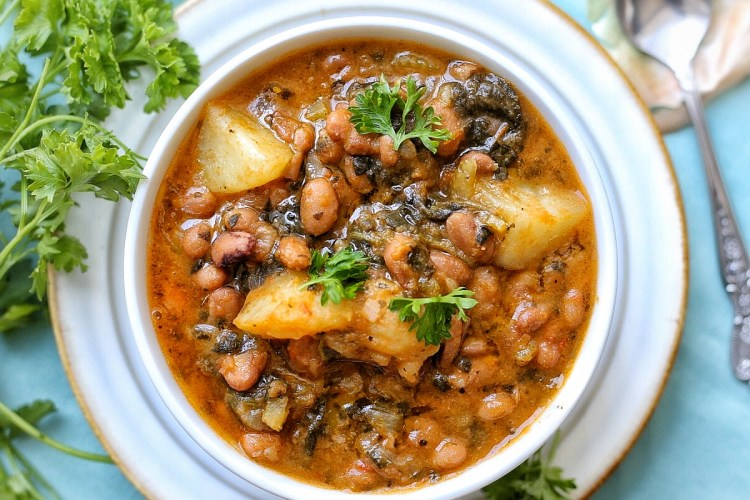 Dutch oven potatoes and pinto beans stew