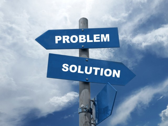 "A Pole With Arrows on It Saying ""Problem"" and ""Solution"""