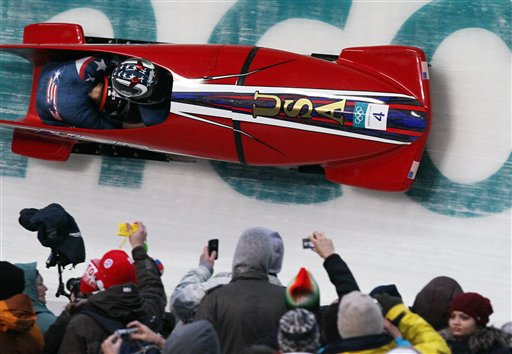 USA-1, piloted by Sgt. Shauna Rohbock, with brakeman Michelle Rzepka, compete yesterday in the women's two-man bobsled competition final at the 2010 Olympics in Whistler, British Columbia. (AP Photo/Ricardo Mazalan)