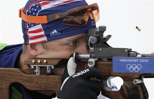 Sgt. Jeremy Teela shoots during the men's biathlon 10 km sprint event at the Vancouver Olympics on Sunday. (AP Photo/Jin-man Lee)