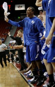 Air Force's Saj El-Amin and the rest of the bench celebrate a run against during Air Force's 59-40 win over Wyoming in the MWC tournament Wednesday. (AP Photo/Laura Rauch)