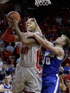 Grant Parker kindly removes an eyelash from the face of New Mexico's A. J. Hardeman during the Falcons' 75-69 loss to the Lobos. (AP Photo/Laura Rauch)