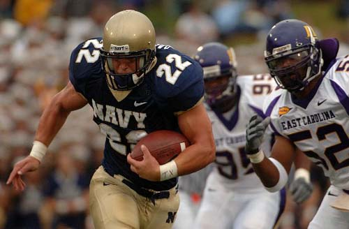 Ex-Naval Academy fullback Adam Ballard runs the ball against East Carolina in 2006. Ballard was recently administrately discharged from the Marine Corps. (Damon J. Moritz/Navy)