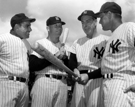 First-year Yankees manager Ralph Houk, right, is shown with, from left, Yankees legends Yogi Berra, Mickey Mantle and Joe DiMaggio during spring training in 1961. (File photo / The Associated Press)