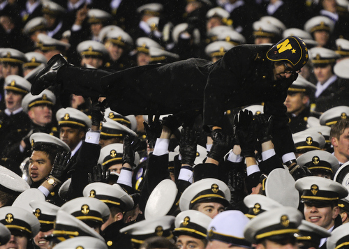Midshipmen celebrate beating Army 34-7 at Lincoln Financial Field in Philadelphia, Pa., on Saturday, December 14, 2013. (Mike Morones/Staff)