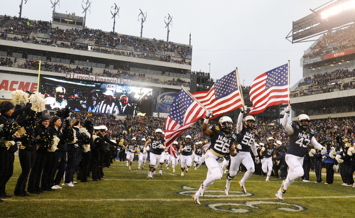 The Midshipmen take the field before the 114th Army-Navy football game at Lincoln Financial Field in Philadelphia, Pa., on Saturday, December 14, 2013. (Mike Morones/Staff)