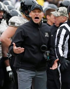 First-year Army coach Jeff Monken, here during his team's loss to Air Force, will take home more than $800,000 in salary this year, USA Today reports, and could add $50,000 by beating Navy. (AP photo by Mike Groll)