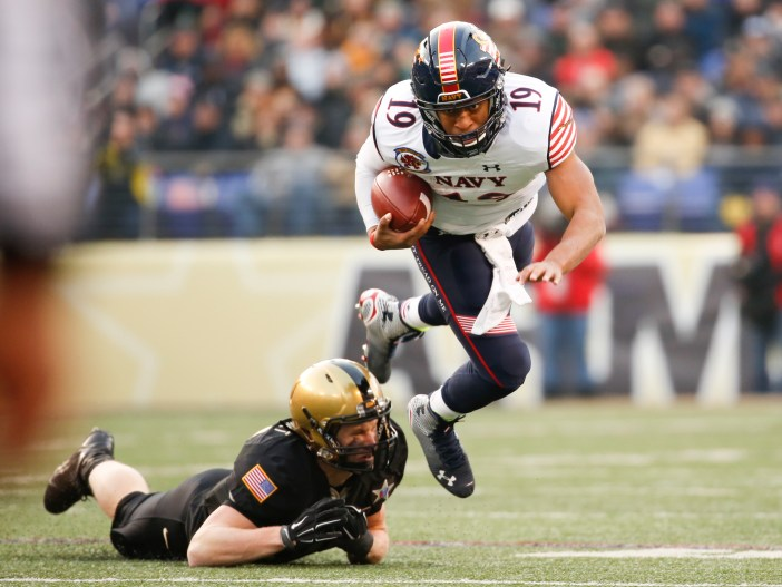 Keenan Reynolds, here escaping a tackle during last year's Army-Navy game, can extend his all-time NCAA rushing-touchdown record Saturday against Tulsa. (Staff photo by Mike Morones)