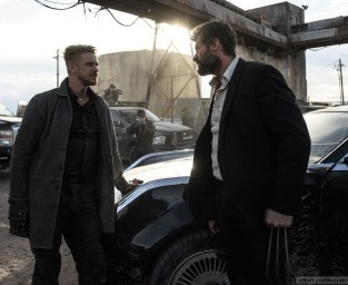 DF-13843_RV2_CROP - Pierce (Boyd Holbrook) and Logan (Hugh Jackman) face off. Photo Credit: Ben Rothstein.