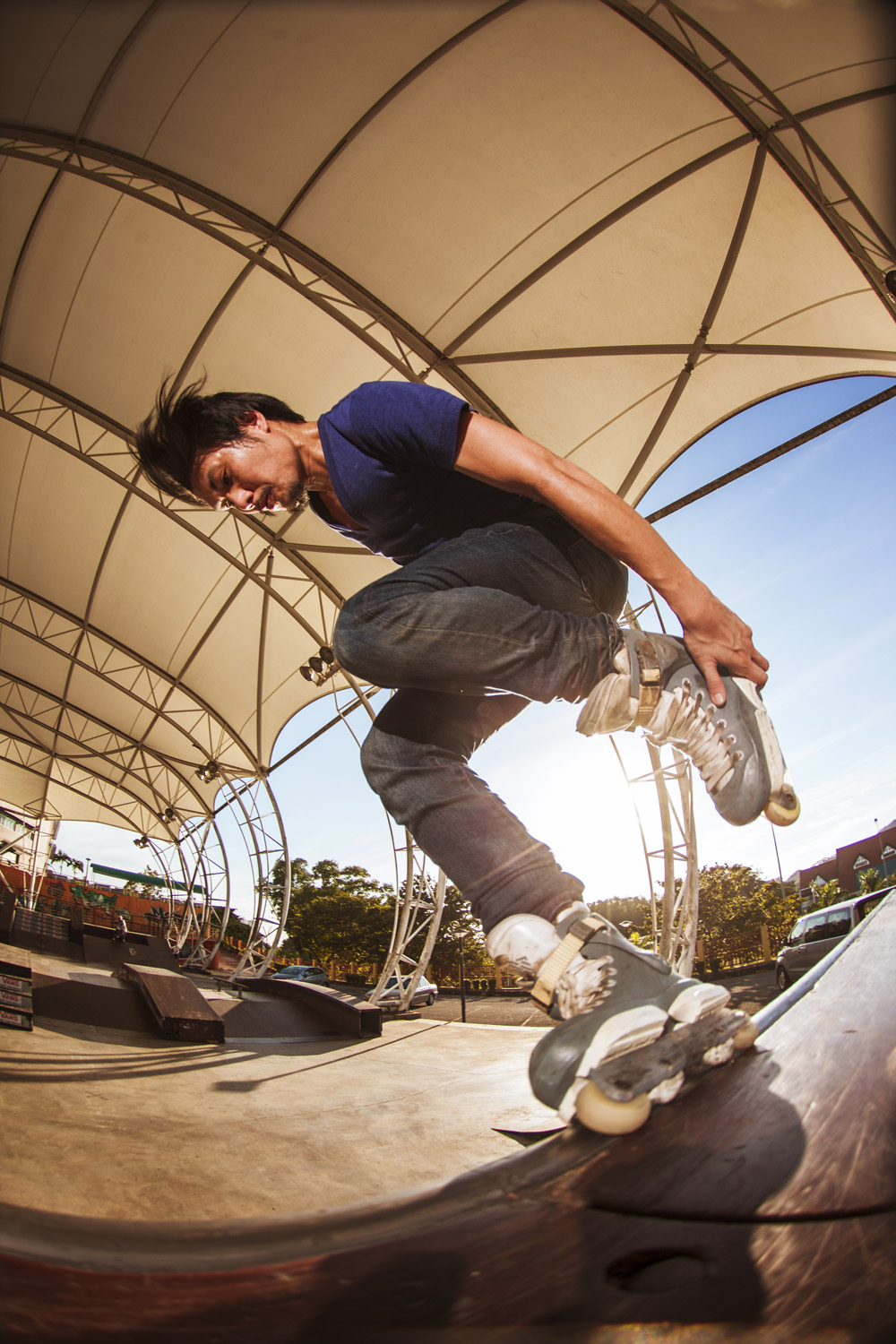 Deyna Siong Alley-oop Fish Brain on the quarter pipe at Mont Kiara Skatepark