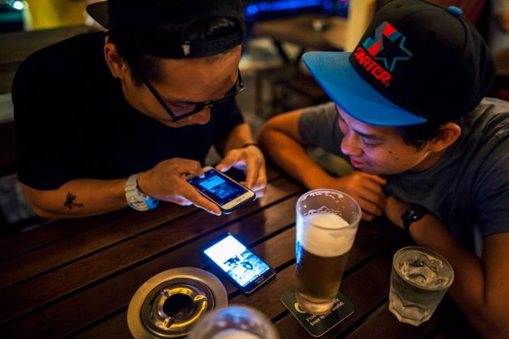 The single guys exchange Tinder tips over beers
