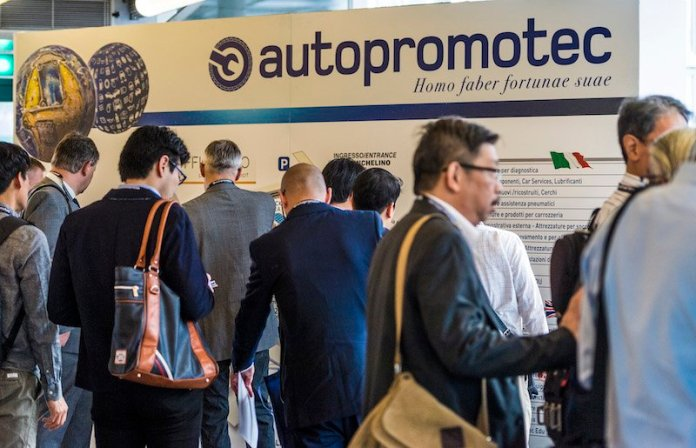 Autopromotec attendees stop to find their bearings before departing to the show.