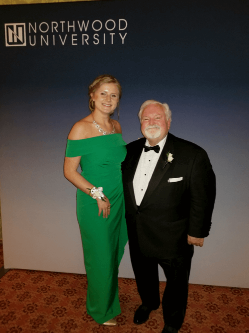John R. Washbish accepted Northwood University's Outstanding Business Leader award at a ceremony in West Palm Beach, Fla., March 16. He is shown here with Morgen Panning, a Northwood University student who introduced him before the award was presented to him.