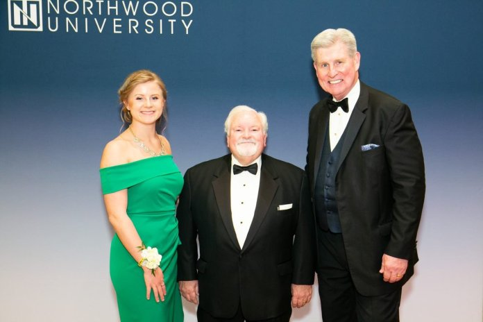 John R. Washbish, president and CEO of the Aftermarket Auto Parts Alliance, is shown here (center) at Northwood University's 39th annual Outstanding Business Leader ceremony in West Palm Beach, Fla. On the left is Morgen L. Panning, the Northwood student who introduced him. On the right side of the photo is Keith Pretty, president and CEO of Northwood University.
