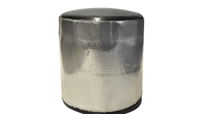 This image shows the DEI Oil Filter heat shield wrapped around the oil filter in the shape of a cylinder. The oil filter heat shield is a metallic silver color.