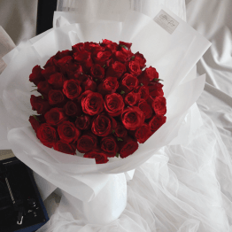 Classic style red roses bouquet with white wrapping paper