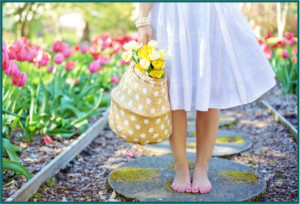 picture of young lady barefoot in garden