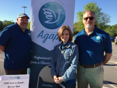 Photo of Agape Sign and Board Members
