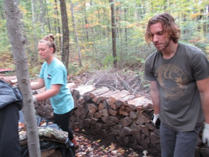 Carley and Matt moving firewood into Francis House