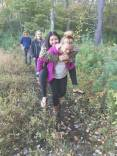 Carley giving Xochitl a piggyback ride across long wet stretch of Quabbin walk