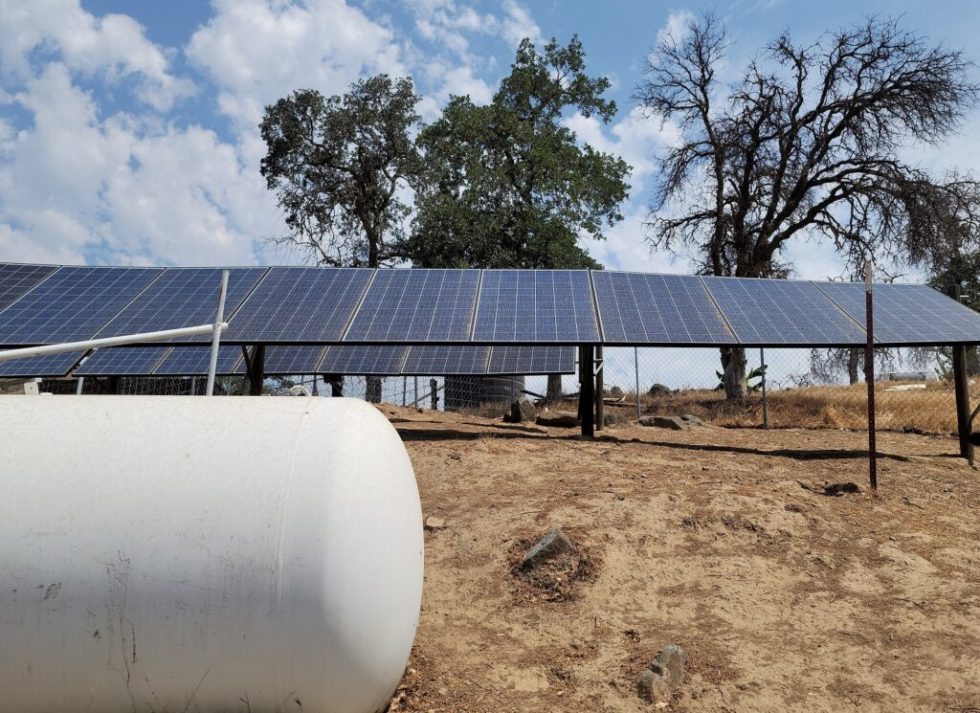DIY fence post and rail rack system for 2 banks of 9 solar panels.