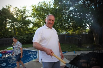 Gary Sanders, founder of Military Missions Network grilling some burgers at an Officers' Christian Fellowship cookout.