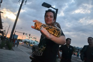 Brett Greenleaf walks around with his snake at First Friday in downtown Phoenix on Septemper 4, 2015.