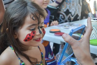 Belizia Paul is happy with her face painting at Brazilian Day in Scottsdale, Arizona on September 19, 2015.