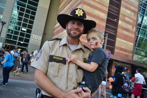 Weller shows his Walking Dead costume along with his son at Comicon in downtown Phoenix Saturday afternoon.