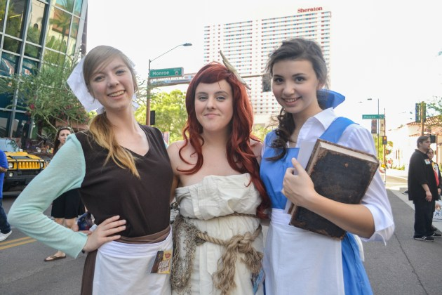 Maddy Stewart (left), Bailey Smith (middle), and Emily Wood (right) take pride in their Disney princess costumes at Comicon in downtown Phoenix Saturday afternoon.