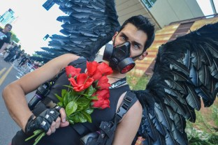 Roxas Razzles grasps his roses at Comicon in downtown Phoenix Saturday afternoon.
