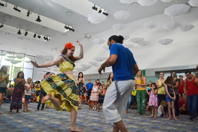 Axe Capoeira dancers dance to Brazilian music at Brazilian Day in Scottsdale, Arizona on September 19, 2015.