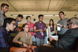 Students listen during an interview excercise in the Summer Journalism Program on June 4, 2015.