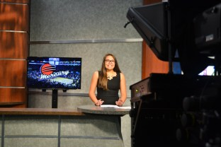 Danielle Gee does the sports newscast during the Summer Journalism Program on June 10, 2015