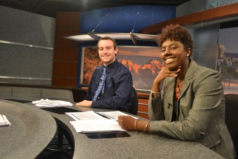 John Leffue (left) and Myasia Mclaren (right) have a good time running their segment during the Summer Journalism Program on June 10, 2015.
