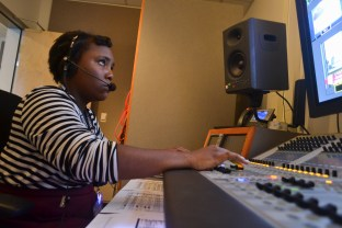 Christiane Crawford runs the audio for the news segment during the Summer Journalism Program on June 10, 2015.