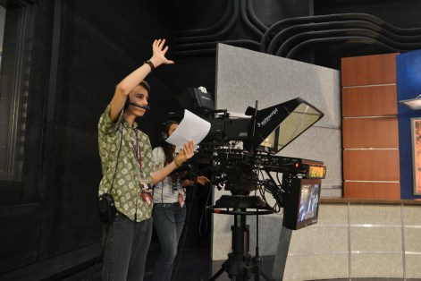Noah Clark directs his news team during their segment in the Summer Journalism Program on June 10, 2015.