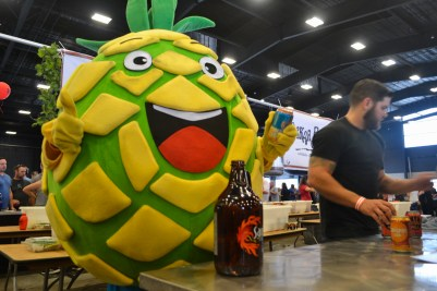 A mascot promotes its companies alchohol at the Scottsdale Beer Palooza on June 20, 2015.