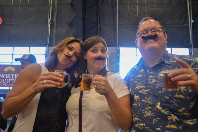 Geeleah York (left), Stacy Kosoff (middle), and Mark Struboe (right) enjoy their beer at the Scottsdale Beer Palooza on June 20, 2015.