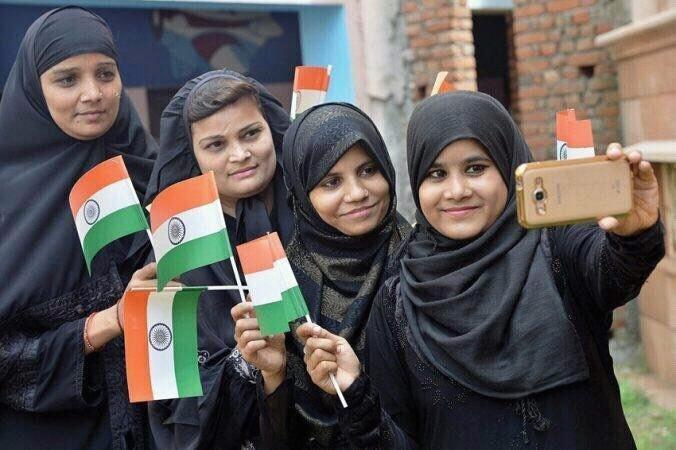 muslim womens taking selfie.jpg