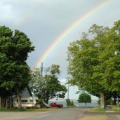 While working the museum one day, a brilliant rainbow formed over Grand Marais bay.